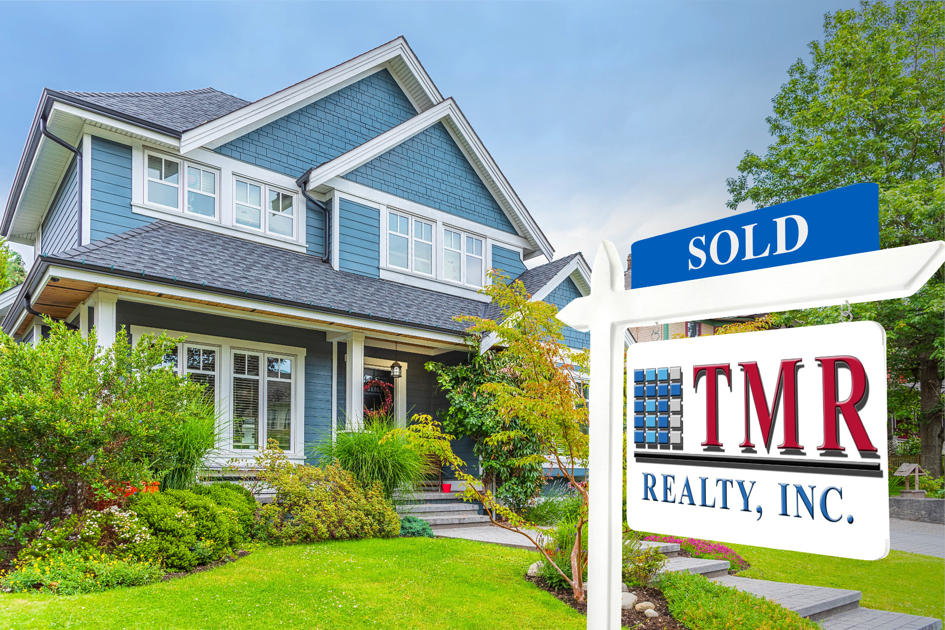 photo of home with TMR Realty signage