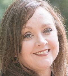 headshot of Monica Roane